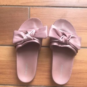 Young women Steve Madden pink slides.